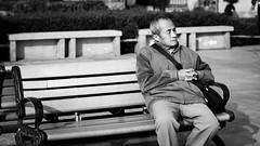 Sunbathing (Go-tea 郭天) Tags: canon eos 100d 50mm street urabn city qingdao china asia chinese asian people outside outdoor monochrome bw bnw black white blackwhite blackandwhithe old guy man sleeping sleep resting rest nap public area bench sun relax relaxing enjoy enjoying alone seated sunny bag coat cold wood tired portrait