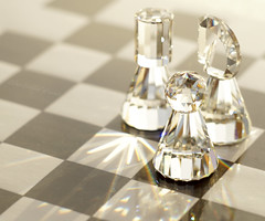 Arrows of light (Elisafox22 catching up ;o)) Tags: elisafox22 sony helios442 f4 hmm macromondays arrow swarovskicrystal sunlight shadows prism facets glass chess chesspieces knight pawn rook castle chessboard squares blackandwhite elisaliddell©2016 sonyslta58