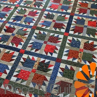 Marna's Bear Paw quilt is on the blog! www.pieceandquilt.com #longarmquilting #piecenquilt #quilt #scrappyquilt