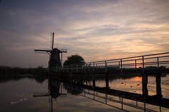 Sunset at Kinderdijk - 1 August 2014 (Wilma v H - on holiday!!) Tags: bridge reflections landscape ducks sunsets windmills unescoworldheritagesite kinderdijk windmolens silhouetttes dutchwindmills bestcapturesaoi coth5