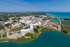 Northwestern University, North Campus (clarsonx) Tags: college landscape illinois day unitedstates shoreline aerial lakemichigan clear shore evanston lakefill bahaitemple northwesternuniversity drone chicagoist ryanfield allencenter kelloggschoolofmanagement quadcopter lakesidefield djiphantom2vision