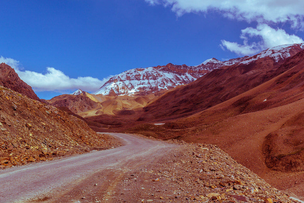 road travel blue sky mountain mountains nature rock clouds landscape highway scenic peak hills valley leh manali himalyas
