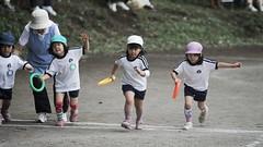 The first runner in a relay - kindergarten Sports Festival.