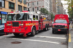 FDNY Tower Ladder 12 and Chemical Protective Clothing Ladder 12 (Triborough) Tags: nyc newyorkcity ny newyork ford chelsea firetruck cpc fireengine ladder fdny seagrave f450 newyorkcounty towerladder fseries newyorkcityfiredepartment ladder12 towerladder12 knapheide cpcl12