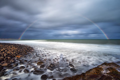 Full Rainbow at Embleton Bay, Northumberland (MelvinNicholsonPhotography) Tags: embletonbay dunstanburgh northumberland coastal rainbow sea storm stormyskies blue longexposure leefilters lee gitzo manfrotto mindshift melvinnicholsonphotography landscapephotographyworkshops landscapeworkshops canonuk canon5ds seascape rocks