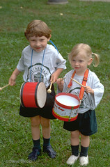 Drummers (Spike's Shoes) Tags: boy girl male female children child kid youngster juvenile juveniles innocence innocent preschool people person white caucasian playing drumming sister brother siblings musicians family drums snare bass summer vertical outdoor outside daytime daylight color colour image photo photograph picture city minnesota mn midwest usa america north american stpaul drummers steveskjold selbydayparade c323305 street photography onewordtitle unitedstates