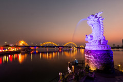 Dragon Bridge in Da Nang Vietnam (mr.yan98) Tags: danang vietnam hanriver river water reflection dragonbridge caurong orange city urban landmark symbol view sunset dusk evening cachephoarong fishstatue
