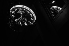 Clocks Ticking (pillarsoflight) Tags: portland pdx oregon city pnw beauty apsc crop sensor nikon d3300 35mm aperture prime lightroom adobe shotonsandisk sandisk apple imac pacificnorthwest nik colorefex bw blackandwhite monochrome desaturated grey black gray white clock numbers night stark contrast filmefex numbered hands drama time portlandoregon downtown pearl pearldistrict reflection reflections mirrored