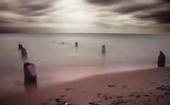 Drowning (blakbrown71) Tags: lake michigan sea ocean ruins marine water weather long exposure sand rocks clouds light