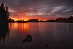Tomorrow's Beginning (Brian Truono Photography) Tags: california park longexposure trees sunset sky sun lake reflection water rock clouds america landscape volcano nationalpark glow nps dusk horizon fineart surface pinecone hdr highdynamicrange lassen manzanita neutraldensity