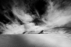 clouds, sand dunes and a row of bamboo fence (bamboolizer) Tags: bw monochrome nikon dune taiwan taoyuan bwcpl 24mmf35pce lee9ndsoftfilter