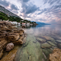 Rocky Beach and Small Village near Omis in the Morning, Dalmatia, Croatia (ansharphoto) Tags: city morning travel blue sea summer vacation sky house mountain seascape building tree green beach nature water rock stone skyline architecture clouds marina sunrise landscape dawn bay coast boat town seaside twilight europe mediterranean riviera european cityscape turquoise azure rocky croatia landmark lagoon resort shore adriatic balkan dalmatia omis mimice splitdalmatiacounty