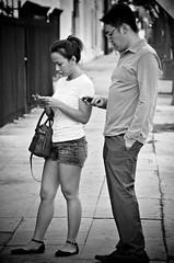 Textlings (Pedestrian Photographer) Tags: california ca bw woman white man black beer cali asian la los waiting couple angeles walk broadway may hike east southern sidewalk socal taco eastside phones texting ribbet 2014 bway dsc4649 dsc4649b