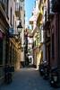 Narrow street of Seville (João Madeira) Tags: street canon calle sevilla spain espanha seville espana rua sevilha canon400d