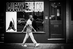 Lucky Black (The Image Den) Tags: candid streetphotography humour shopwindow southampton passerby racist opportunist trite blackguy simplistic luckyblack onslowrd