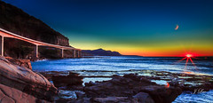 Sunrise at Ocean Bridge (**James Lee**) Tags: ocean longexposure bridge sunset sun seascape nature colors sunrise landscape rocks ray colours australia nsw woollongong jameslee coalcliff