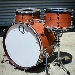"""Satin mahogany shells 22, 13, 16. Dark red mahogany stain on the bass drum hoops with larger 3/4"""" white marine pearl inlays. Added some NOS Ludwig bass drum T rods to finish the classic vibe. #qdrumco #mahogany #drums"""