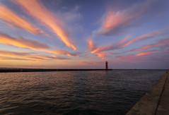 lighthouse sunset (olsonj) Tags: light sunset sea lighthouse lake water clouds lakemichigan