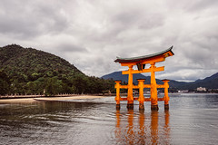 The Sacred Gate (Pikaglace) Tags: sony a7 miyajima japan japon island ile torii tori sea asie asia vintage feel mood faded colors orange red rouge clouds cloudy reflection religion religious shinto entrance sacred travel