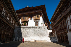 Inside Trongsa Dzong (whitworth images) Tags: stone administration building buddhist courtyard himalaya person himalayas bhutan enormous religion monk interior travel ancient historic inside dzong white government huge large old asia religious monastery culture buddhism architecture trongsa fortress trongsadzong paved traditional trongsadzongkhag