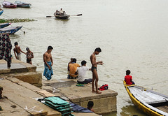 People wash themselves in the river Ganges in India (phuong.sg@gmail.com) Tags: asia asian bank bath bathing benares blessing ceremony clothes color colorful dirty diversity dress ethnic ganga ganges ghat hindu hinduism holy india indian men morning outdoor outside people person polluted pray prayer puja religion ritual river riverbank sacred spirituality steps tourism travel traveler varanasi wash water