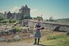 Welcome to Scotland (Rhia.photos) Tags: cliché outdoor scotland scottish eileandonan castle history historic eileandonancastle kilt bagpipe bagpiper building image photo photograph photography bridge rocks