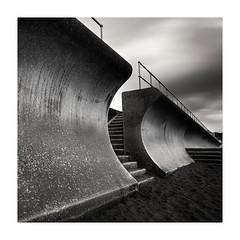 Beach Access (richieJ 11) Tags: teignmouth devon wall steps rails curves mono blackandwhite monochrome squarecrop sand coast longexposure