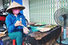 Barbecue queen (Roving I) Tags: conicalhats cooking barbecues grilling meat pork smokefacemasks electricfans skewers chopsticks cafes danang vietnam streetfood tradition vietnamesecuisine