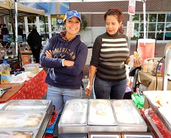 Venezuelen smiles (Just Back) Tags: fair market ladies pretty smiles arms columbia sc sodacity cachito street eat food tasty snacks lunch treats
