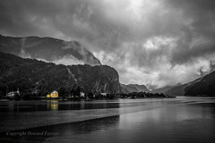 The yellow house (Howard Ferrier) Tags: fjord eidslandet residentialbuildings inlet reflection house mountain architecture overcast norway europe cliff clouds hordaland no