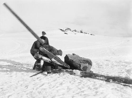Men moving a rune stone at Väntholmen, Hilleshög, Uppland, Sweden