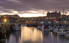 Scarborough Harbour (M Hillier) Tags: scarborough harbour boats wall jetty moorings mooring sunset dusk golden hour grand hotel clouds overcast sea ocean calm smooth longexposure yorkshire starburst lights sparkle coast seaside water winter