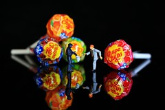 Gimme the lolly (under_exp0sed) Tags: macro reflection canon studio toy toys miniature model toystory sweet mini lolly plastic sweets westcott 187 hmm reflector icelight chupachups tinypeople miniatureworld hoscale lastolite preiser 18135mm strobist 60d macromonday happymacromonday