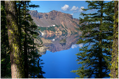 Crater Lake Through the Trees (ScottElliottSmithson) Tags: blue trees mountain lake mountains reflection nature beauty oregon forest canon spectacular landscape eos volcano woods scenery northwest azure crater caldera cascades 7d pacificnorthwest craterlake nationalparks mountainlake cascademountains cascaderange astonishing craterlakenationalpark usnationalparks thecascades eos7d dtwpuck scottsmithson scottelliottsmithson