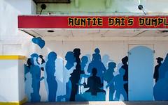 Blue Shadow People (Jocey K) Tags: city blue newzealand christchurch colour art wall architecture facade buildings words mural paintings nz cbd newregentst blueshadowpeople friezestandinthesun jremysauzier