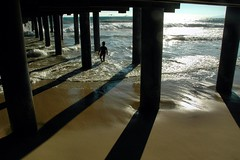By Himself (EmperorNorton47) Tags: california summer digital pier photo afternoon shadows santamonica silhouettes underneath santamonicapier pylons