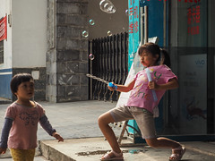 xing ping bubbles copy (anwoody) Tags: xingping streetlife