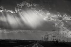 my light through storms... (Alvin Harp) Tags: texas thunderstorm lightbeams sunlight light stormclouds darkclouds cloudy highways telephonepoles utilitypoles powerlines monochrome blackandwhite bw april 2014 sonynex5r trucking rainy rain