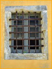 Barred (abriwin) Tags: portugal peniche prison window barred yellow