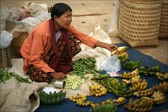 Selling bananas at the market (*Kicki*) Tags: myamnar burma inlelake inlaylake inlay inle bananas woman person people fruit shopping selling market baskets food shanstate longyi thanaka beans marketday street streetscene