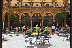 Alfonso Hotel, Seville (yonca60) Tags: seville sevilla spain andalusia hotelalfonso hotel lunch people yard frame courtyard balcony tables ferforje chair restaurant