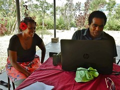 Like What They See (mikecogh) Tags: vanuatu espiritusanto video filming esther steeve colleagues laptop review happy satisfaction