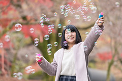 Young woman playing with soap bubbles on dead railroad track (Apricot Cafe) Tags: 20s asianethnicity canonef70200mmf4lisusm japan japaneseethnicity kyoto minikyoto2016 autumn autumnleaves beautyinnature bubbles change charming cheerful enjoying foliage freshness happiness hope japanesefallfoliage japanesemaple leaves mapleleaf nature oneperson onlywomen outdoors people railroadtrack refreshing selectivefocus soapbubbles tranquility traveldestinations walking wishing woman youngadult