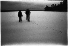 Crunching footsteps (batuda) Tags: film 35mm analog analogue bw blackandwhite om2n om 2835 ilford hp5 d76 dark longexposure wide wideangle winter snow landscape ice lake trees sky human silhouette foot feet footsteps evening night grain tauragnas taurapilis šinkūnai tauragnai utena lithuania lietuva