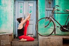 IMG_0717ChristineHewitt_YogicPhotos (yogicphotos) Tags: travel family red woman india heron bicycle yoga women julie stretch cycle mysore asana flexible christinehewitt yogapants krounchasana yogafamily heronpose yogaphotography yogaphotographer yogicphotos