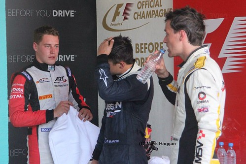 Mitch Evans, Stoffel Vandoorne & Jolyon Palmer prepare to go to the podium after the GP2 Feature Race at the 2014 German Grand Prix
