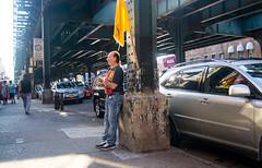 Brighton Beach (UrbanphotoZ) Tags: nyc newyorkcity ny newyork man brooklyn standing subway traffic pillar tshirt sidewalk jeans pedestrians column elevated brightonbeach leaning