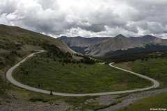 Curve in the Road (isaac.borrego) Tags: road mountains clouds colorado pass alpine rockymountains peaks curve tundra cottonwoodpass canonrebelt4i