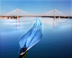 From Out of Nowhere (Darrell Wyatt) Tags: bridge blue water train wow boat speedboat columbia fromthetrain kennewick pasco