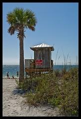 Lifeguard Shack (Light Vessel) Tags: ocean sea beach vertical seaside sand pentax florida lifeguard palm hut oceanside palmtree vista shack swimmers seashore sunbathing sanddunes glimmering k5iis